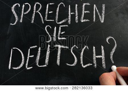 Learn German Concept. Sprechen Sie Deutsch Sign On A Blackboard.