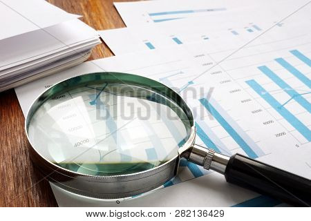 Audit And Accounting Concept. Magnifier And Business Papers.