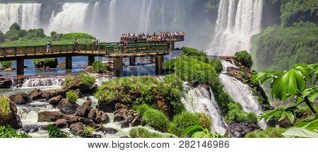 Iguazu, Argentina - November 12, 2012: Tourists Viewing The Waterfalls On The Platform In Iguazu Nat