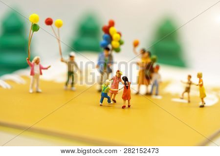 Miniature People: Family And Children Enjoy With Colorful Balloons, Happy Family Day Concept.