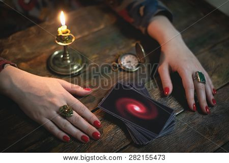 Tarot Cards And A Woman Fortune Teller. Future Reading Concept. Divination.