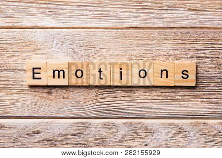 Emotions Word Written On Wood Block. Emotions Text On Wooden Table For Your Desing, Concept
