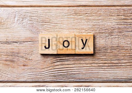 Joy Word Written On Wood Block. Joy Text On Wooden Table For Your Desing, Concept