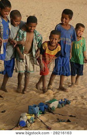 Berber Nomad Children in the Sahara Desert With Homemade Toys