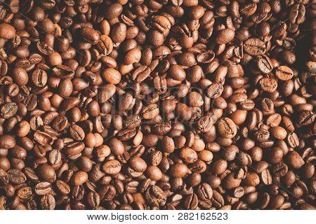 Fresh Brown Coffee Beans Vintage Background. Grain Coffee