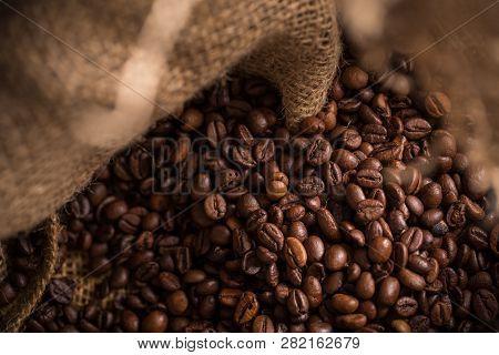 Fresh Brown Coffee Beans In Jute Bag.