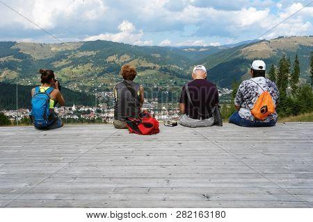 Vatra Dornei, Romania - August 20, 2016: Tourists Are Watching A Panorama Of The City Of Vatra Dorne