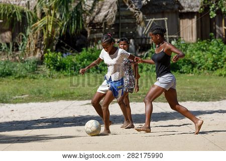 Maroantsetra, Madagascar - November 23 2016: Happy Malagasy Children, Boys And Girls With Bare Feet
