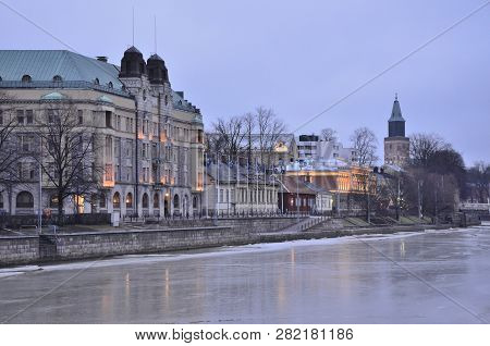 Turku, Finland. Quay Of The Aura River In Winter Twilight