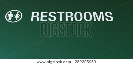 Male Female Restroom Sign. Green Colored Sign With Symbol For Male And Female Restrooms In Horizonta