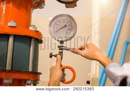 Asian Engineer Maintenance Checking Technical Data Of  System Equipment Condenser Water Pump And Pre