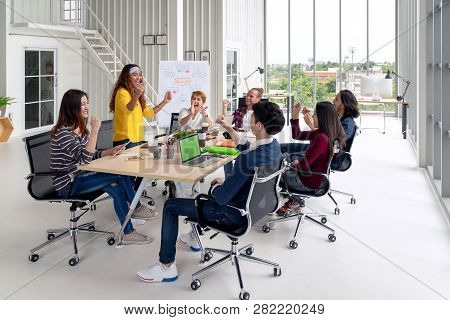 Group Of Young Attractive Asian Creative Design Team Meeting At Office Celebrating Success Or Winner