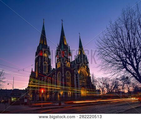 Nightscape Of Ancient Gothic Church With Autotracks
