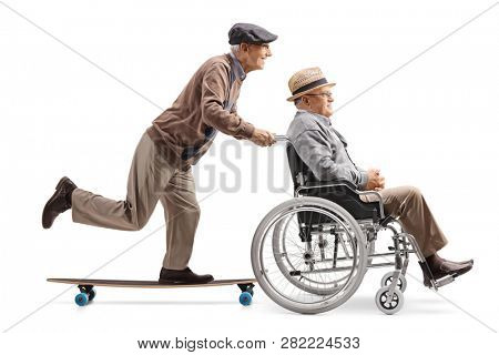 Full length profile shot of an elderly man pushing a man in a wheelchair isolated on white background