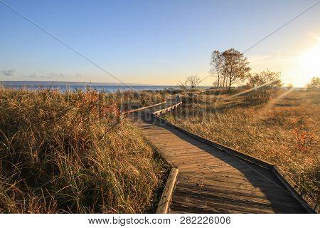 Sunny Beach Boardwalk. Winding Boardwalk Path Along The Lake Superior Coast In Michigan.