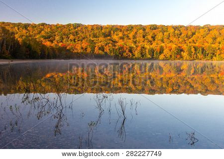 Autumn Lake Reflections. Vibrant Fall Foliage Reflected In The Clear Water Of Monocle Lake In The Hi