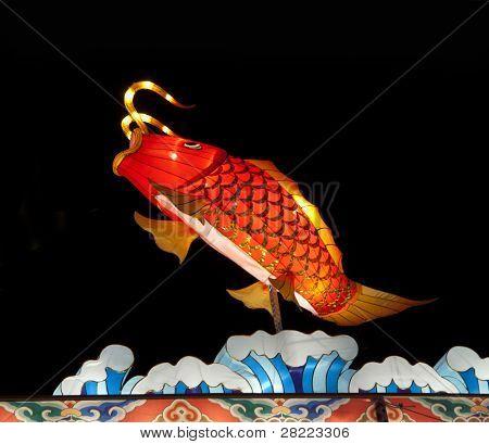 Illuminated Chinese lantern Fish on dark sky background poster
