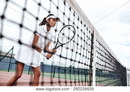 Concentration Is Your Superpower. Beautiful Woman Is Playing Tennis