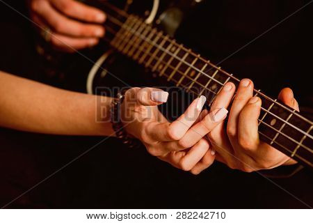 We Love Music. Couple In Love Play Duets. Male And Female Hands Play The Electric Guitar. Couple Of