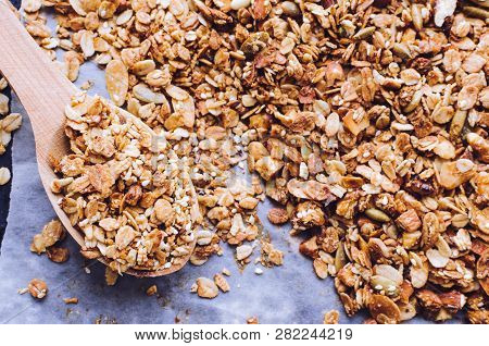 Homemade Roasted Granola On Baking Sheet With Sesame, Pumpkin, Sunflower Seeds, Nuts And Almonds. Su