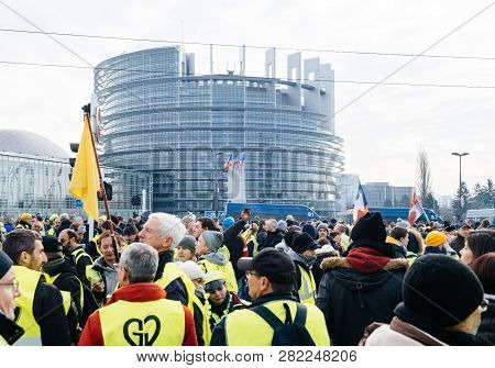 Strasbourg, France - Feb 02, 2018: Gilets Jaunes Yellow Vest Protesters With French National Flag Ma