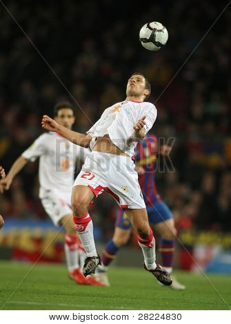 BARCELONA - MARCH 24: Krisztian Vadocz of Osasuna in action during a Spanish League match between FC Barcelona and Osasuna at the Nou Camp Stadium on March 24, 2010 in Barcelona, Spain