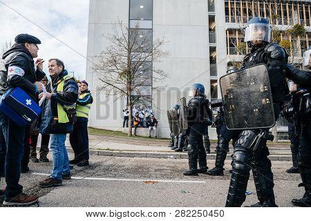 Strasbourg, France - Feb 02, 2018: Side View Of Armed Police Officers Brigade Anti-criminalite De La