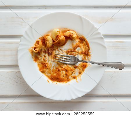 Leftover Of The Pasta On White Plate