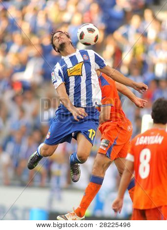 BARCELONA - AUGUST 29: Osvaldo of Espanyol in action during a Spanish League match between RCD Espanyol and Getafe at the Estadi Cornella on August 29, 2010 in Barcelona, Spain