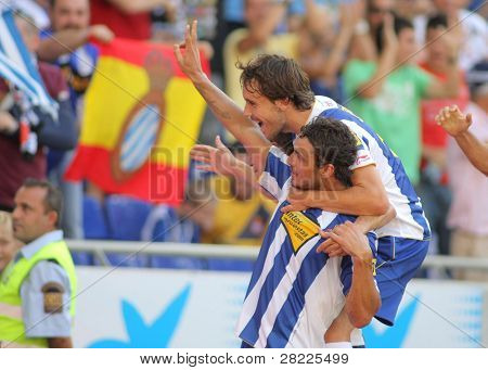 BARCELONA - AUGUST 29: Osvaldo and Verdu of Espanyol celebrating goal during a Spanish League match between RCD Espanyol and Getafe at the Estadi Cornella on August 29, 2010 in Barcelona, Spain