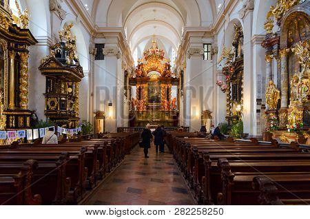 Prague, Czech Republic - January 22, 2019: Unidentified People Visit Church Of Our Lady Of Triumphan