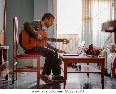 Learning To Play The Guitar. Interesting Hobby Or Professional Occupation Of Music. Music Education