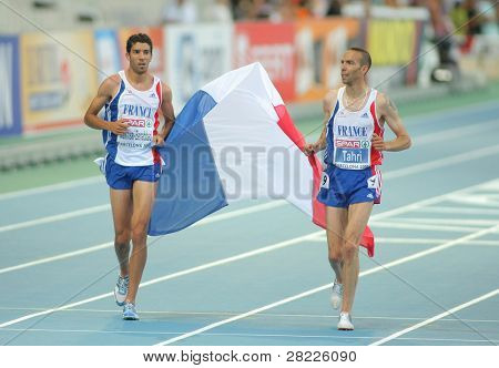 BARCELONA, SPAIN - AUGUST 01: Mekhissi-Benabbad(L) and Tahri(R) of France celebrate medals on 3000m steeplechase of the 20th European Athletics at the Olympic St. on August 1, 2010 in Barcelona, Spain