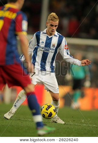 BARCELONA - DEC 12: Griezmann of Real Sociedad in action during a Spanish League match between FC Barcelona and Real Sociedad at the Nou Camp Stadium on December 12, 2010 in Barcelona, Spain