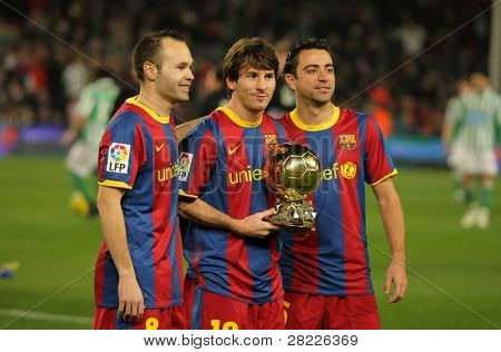 BARCELONA - JAN 12: (L-R) Iniesta, Messi and Xavi of Barcelona with golden ball before a Spanish Cup match between FC Barcelona and Real Betis at the Nou Camp Stadium on January 12, 2011 in Barcelona, Spain