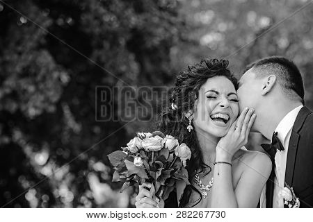 Couple In Love Kiss And Smile On Wedding Day. Couple In Love On Summer Outdoor.