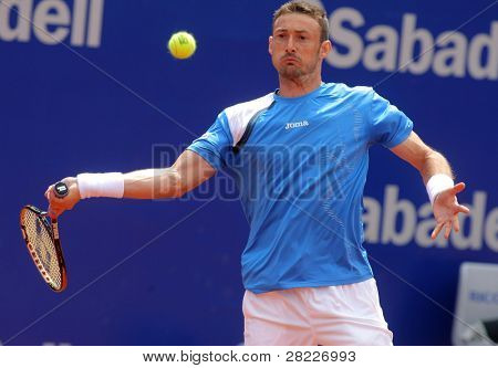 BARCELONA - APRIL 19: Spanish tennis player Juan Carlos Ferrero in action during his match against Xavier Malisse of Barcelona tennis tournament Conde de Godo on April 19, 2011 in Barcelona, Spain