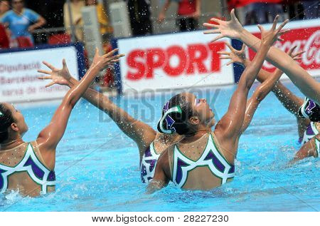 BARCELONA - JUNE 19: Japanese synchro swimmers in a Team exercise during the Espana Sincro meeting in Barcelona Picornell Swimpool, June 19, 2011 in Barcelona, Spain