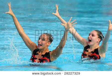 BARCELONA - JUNE 18: British synchro swimmers Jenna Randall(L) and Olivia Allison(R) in a Duet exercise during the Espana Sincro meeting in Picornell Swimpool, June 18, 2011 in Barcelona, Spain
