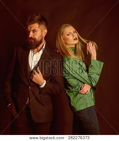 Making Look Good Being Cold. Autumn Street Style. Fashion Couple Of Sexy Woman And Bearded Man. Love
