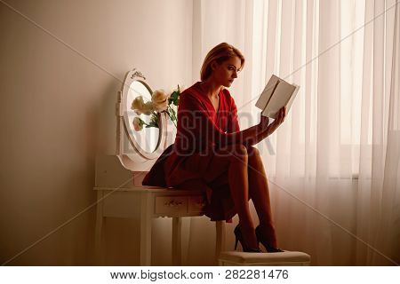Story Reading. Woman Reading Story In Bedroom. Story Reading After Working Day. Woman Reading Book.