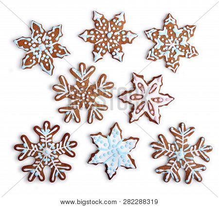 Homemade Snowflake Shaped Gingerbread Cookies With Sugar Icing, On White Background Isolated