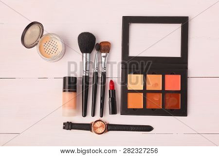 Makeup brush and cosmetics, on a white background. poster