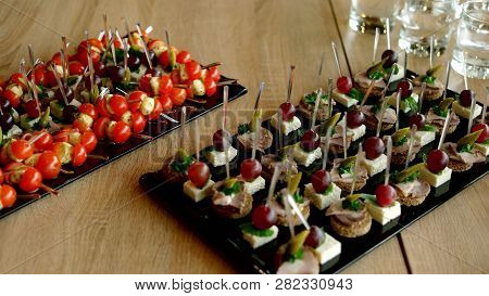 Beautifully Decorated Catering Banquet Table. Catering Service Buffet Plate With Canapes And Appetiz