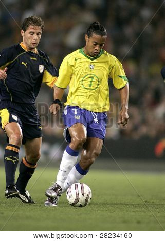 BARCELONA, SPAIN - MAY. 25: Brazilian player Ronaldinho in action during the friendly match between Catalonia vs Brazil at Nou Camp Stadium in Barcelona, Spain. May 25, 2004.