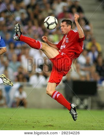 BARCELONA, SPAIN - AUG. 2: Jamie Carragher of RLiverpool FC in action during a friendly match against RCD Espanyol at the Estadi Cornella-El Prat on August 2, 2009 in Barcelona, Spain.