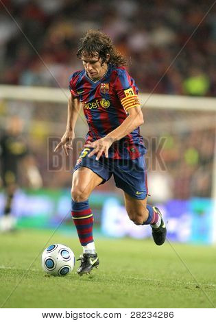 BARCELONA, SPAIN - AUG. 23: Futbol Club Barcelona captain Carles Puyol during Spanish Supercup match between Barcelona vs Athletic Bilbao at the New Camp Stadium in Barcelona on August 23, 2009.