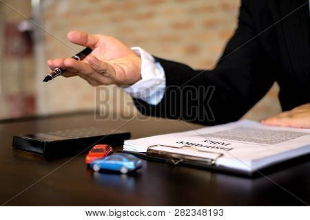 Businessmen Present Contract On Trading - Rent A Car. Businessmen Insurance Car. Business Concept.