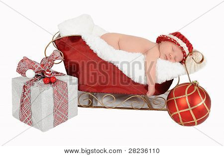 Sweet Newborn Asleep In Santa Sleigh. Isolated