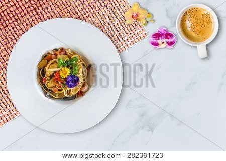 Stir-fried Spicy Spaghetti With Seafoods On White Marble Background. Top View